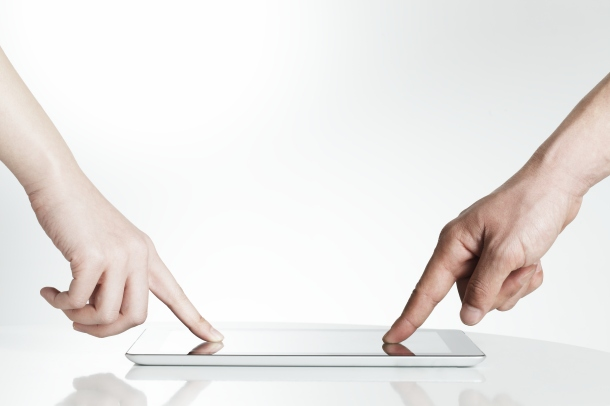 Man and woman touching tablet PC